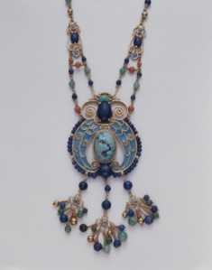 Louis Comfort Tiffany (1848-1933) and Meta Overbeck (1879-1956). Egyptian Revival Bead Necklace, ca. 1925. 18k gold, turquoise, lapis lazuli, coral (corallium rumbrum), green jadeite,  enamel, 42.3 cm. height.Tiffany & Co. 1993.38